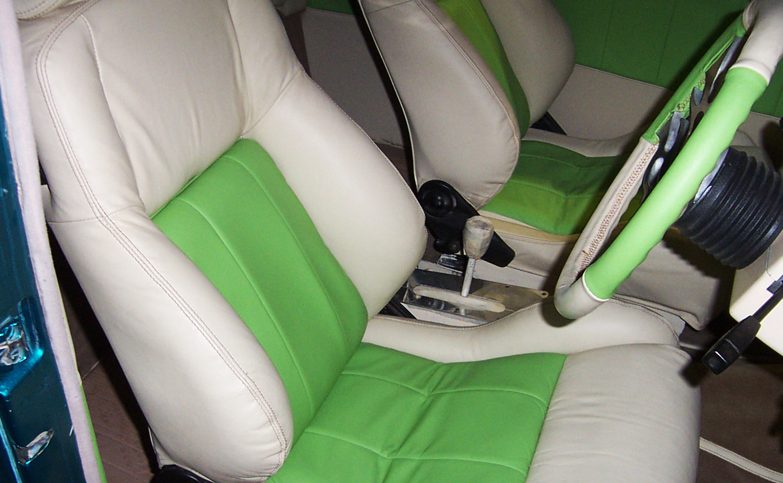 Cream+and+green+interior%2C+panelling%2C+seats+and+steering+wheel