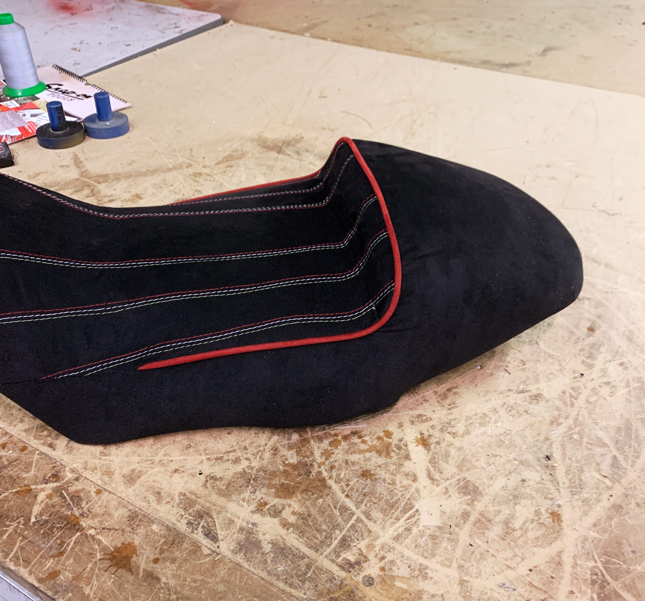 Black+fabric+motorcycle+seat+with+red+and+white+stitching+and+red+piping