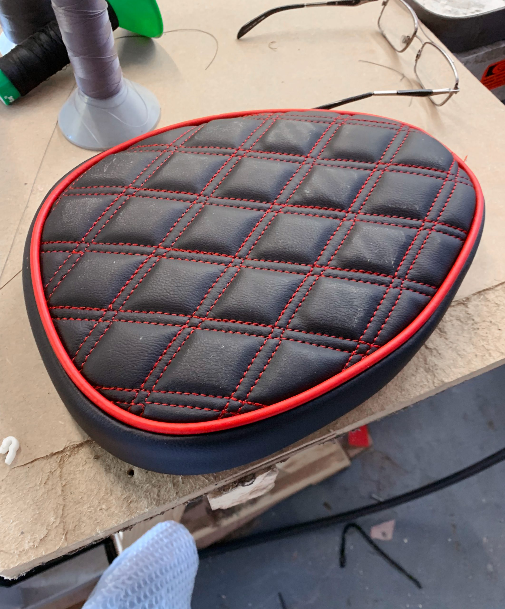 Black+motorcycle+seat+with+red+diamond+stitching+and+piping