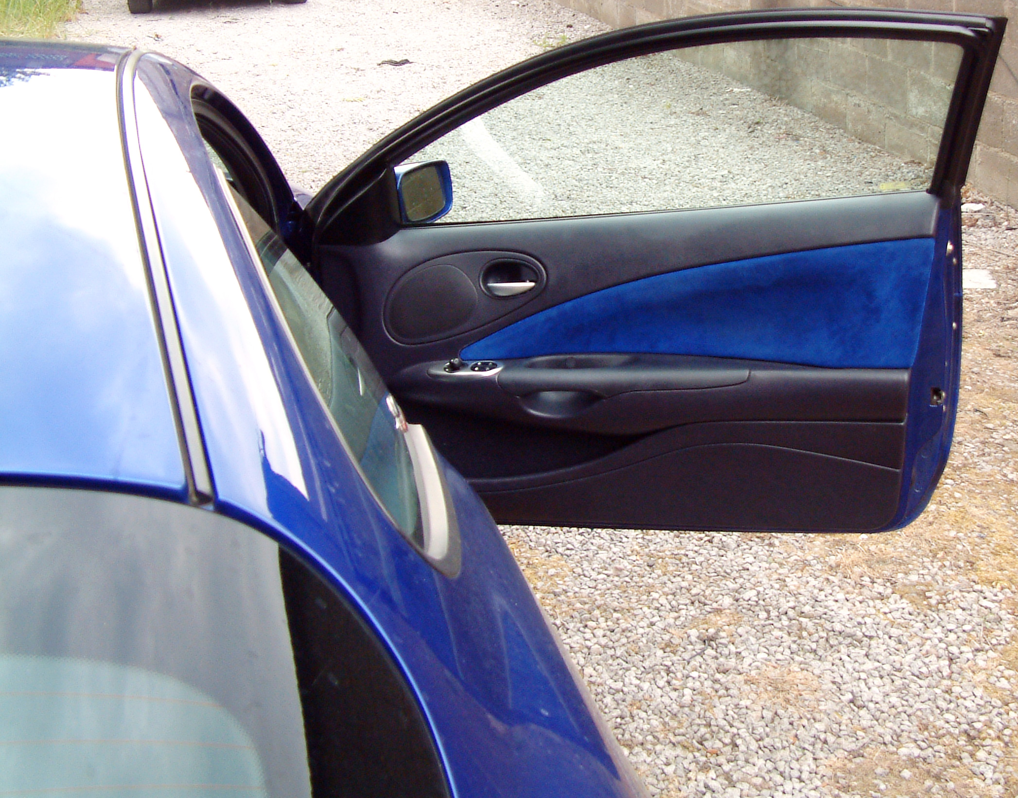 Blue+alacantra+and+leather+door+panel