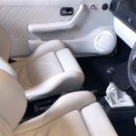 Leather interior, upholstery, panels and detail