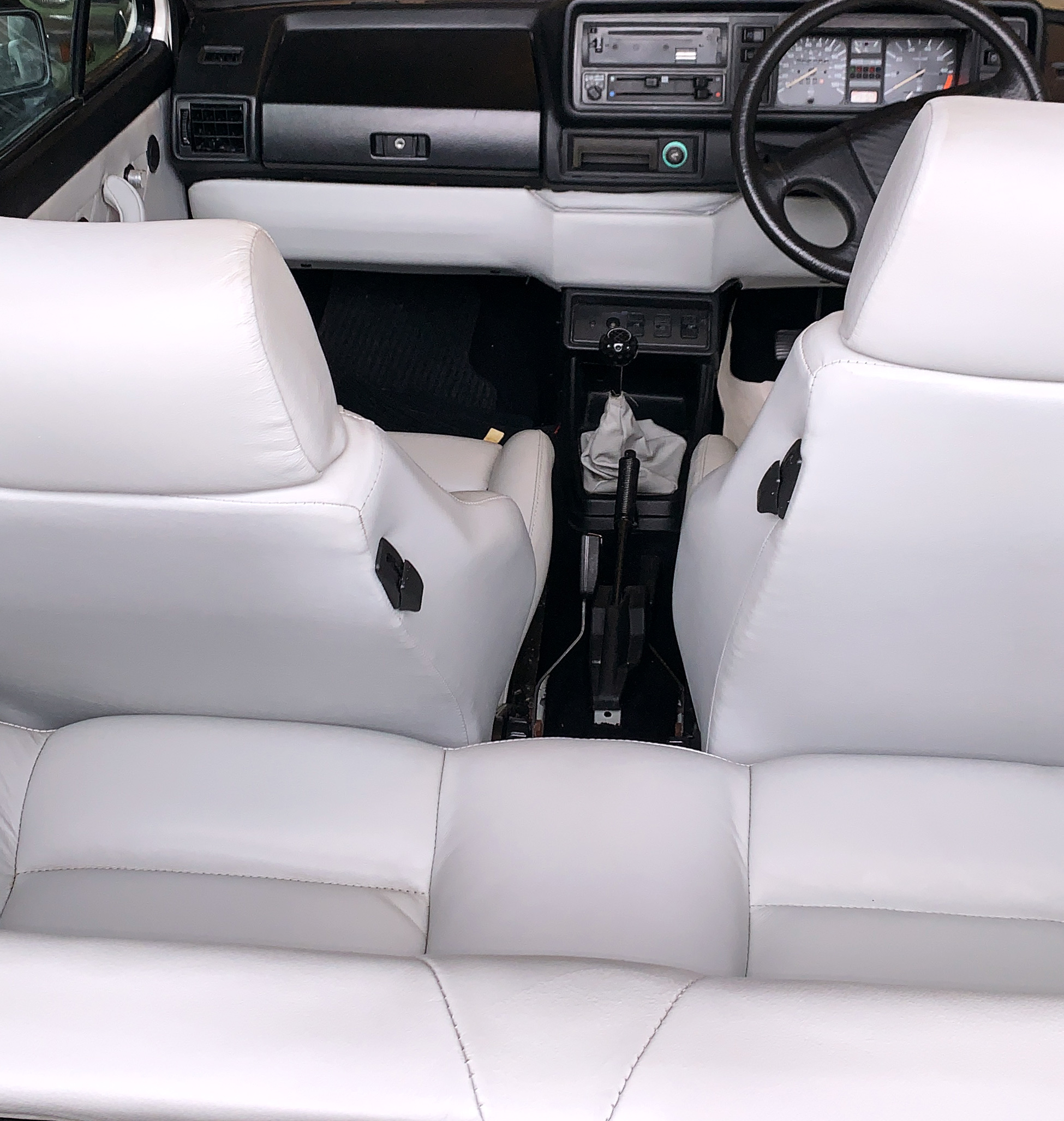 White+leather+car+upholstery%2C+door+panels+and+dash